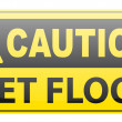 Stock Vector: Wet floor caution