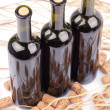 Wine bottles with corks - Stock Photo
