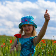 Young blond girl with red flowers — Stock Photo #11096151