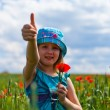 Royalty-Free Stock Photo: Young blond girl with red flowers
