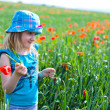 Young blond girl with red flowers — Stock Photo #11096214