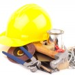 Yellow hard hat and tools on white background — Stock Photo