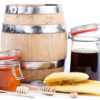 Honey jar and barrel — Stock Photo