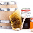 Honey jar and barrel - Stock Photo