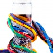 Colorful strings and bottle of water — ストック写真
