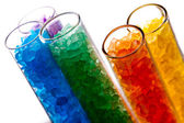Colorful salt crystals in lab test tubes — Stockfoto