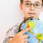 A boy holding a globe — Stock Photo #11137753