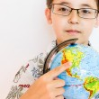 Stock Photo: Boy holding globe