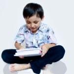 Boy reading a book — Stock Photo #11137788
