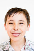 Boy stuck out his tongue — Stock Photo