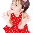 A little girl in red dress — Foto Stock