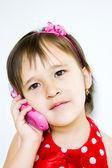 Little girl talking on the phone — Stock Photo