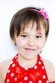Portrait of a little girl in red dress — Zdjęcie stockowe