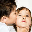 A boy kissing a girl on a white background — Stock Photo #11531621