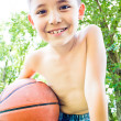 A little boy with ball in his hands — Stock Photo