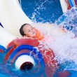Little girl on a water slide — Stock Photo