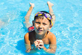 A little boy swimming in the water — Stock Photo