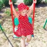 A little girl swinging on a swing — Stock Photo