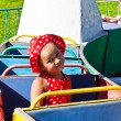 A little girl riding on a children's train — Stock Photo #11805871
