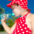 A little girl drinks water — Stock Photo