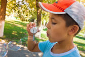 A little boy playing with bubbles — Stock Photo