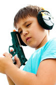 A little boy playing with toy gun — Stock Photo