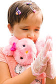 A little girl in a pink dress claps — Stock Photo