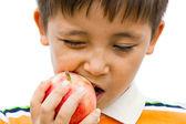 A little boy eating an apple — Stock Photo