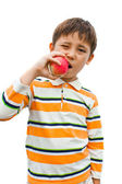Boy eats an apple good for health — Stock Photo