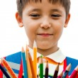 Stock Photo: Schoolboy with colored pencils in their hands