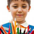 Schoolboy with colored pencils in their hands — Stock Photo