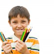 Boy with colored pencils in their hands — Stock Photo