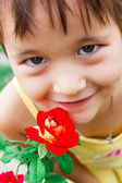 Gentle, sweet girl breathes fragrance of a rose — Stock Photo