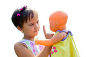 A little girl teaches her doll the rules — Stock Photo