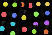 Vinyl records with different colored labels. — Stock Photo