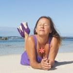 Sexy woman purple dress happy at beach holiday — Stock Photo #11111984