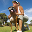 Woman with friend and pet guard boxer bull dog — Stock Photo #11113442