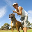 Woman with alert guard boxer bull dog — Stock Photo #11113463
