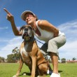 Woman with guard boxer bull dog — Stock Photo #11113492