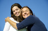 Happy mother hugging happy daughter in friendship — Stock Photo