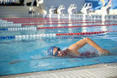 Active Senior woman swimming in pool — Stok fotoğraf