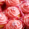 Stock Photo: Cupcakes with pink fondant icing