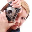 Stock Photo: Pretty young woman with vintage camera