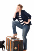 Pretty young woman preparing to leave home — Stock Photo