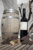 Bottle of wine and cask wine — Stock Photo