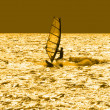 Solitary windsurfer - Stock Photo