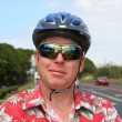 Bicyclist in helmet on the highway — Stock Photo