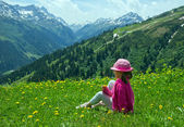 Little girl at Alpine meadows — Stock Photo