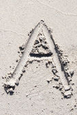 Sand beach alphabet: letter A — Stock Photo
