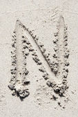 Sand beach alphabet: letter N — Stock Photo